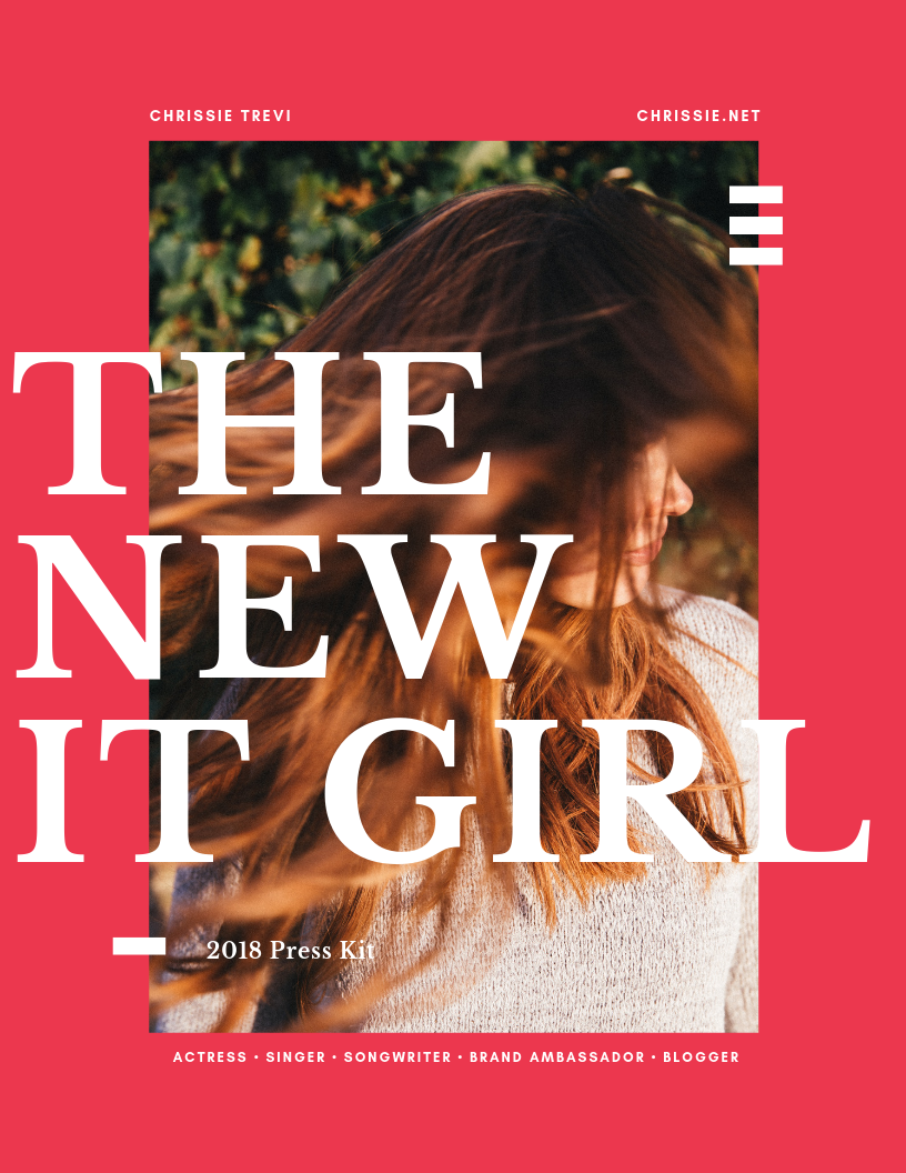 Cover of an EPK Example. Caucasian woman with her tossing about in the wind with the words The New It Girl in capital letters across the picture. It also says 2018 Press Kit